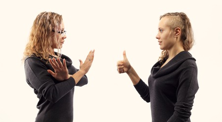 psychics: Part of series. Self talk concept. Young woman talking to herself, showing gestures. Double portrait from two different side views.