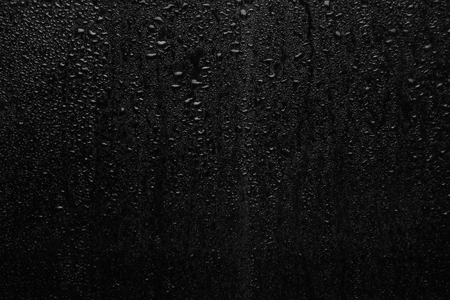Part of series. Background photo of rain drops on dark glass, different size: small medium and large horizontal view Stock Photo