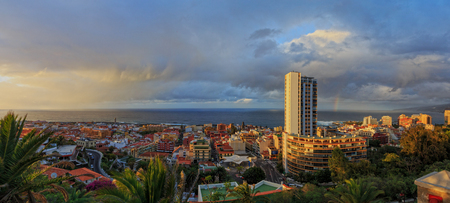 Panoramic view of Puerto de la Cruz, Canary Islands, Tenerife, from Taoro Park on sunset