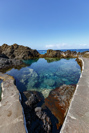 El Caleton de Garachico. Wide angle view of one of natural shallow swimming pools in Garachico, Tenerife, Spain Standard-Bild