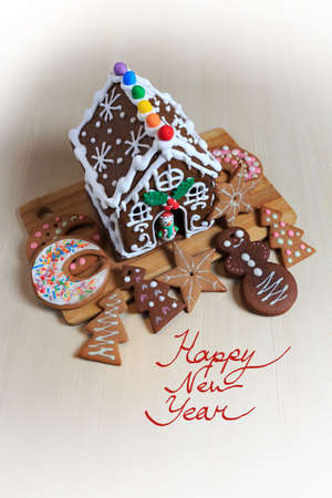 Christmas food decoration template with gingerbread house and cookies cut in different shapes Standard-Bild