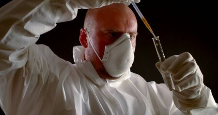 Virologist scientist holds a test tube and reagent for analyzing water for coronavirus. Chinese infection, atypical pneumonia