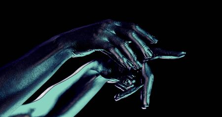 female hands moving in black background, closeup of palms, split of picture and changing colors, psychedelic and hallucinogenic