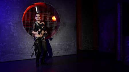 alluring woman is performing sexy dance in studio, dressed black suit