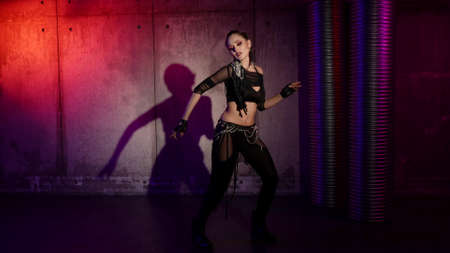 contemporary eclectic dance of young sexy woman dressed black suit, alluring female dancer Foto de archivo
