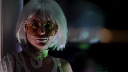 portrait of sexy woman at night indoors, posing against large window, eccentric white wig and trendy glasses Standard-Bild