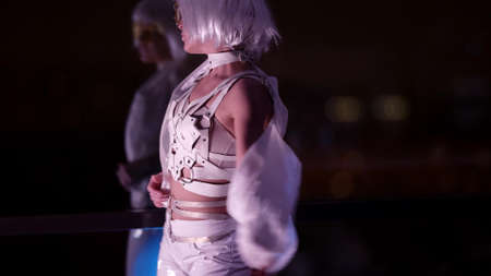 go-go dancer in nightclub, young sexy woman dressed white clothes and wig is dancing Standard-Bild