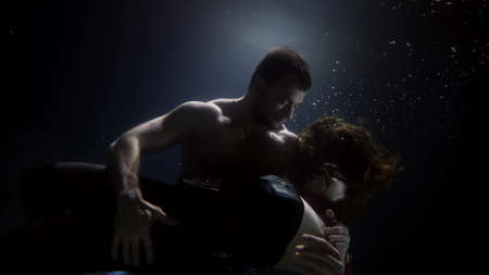 sexy man and woman are embracing underwater, tenderness and sensuality
