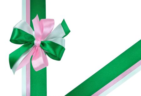 Festive Bow made of Dark Green, Light Green and Pink Ribbons Isolated on White photo
