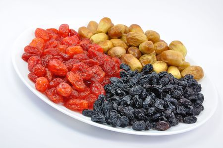 adequate: Dried Dates, Cornelian Cherries and Black Raisins on White Plate Isolated