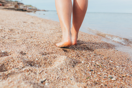 Feet on sea sand and wave, Vacation on ocean beach, Summer holiday Stock Photo