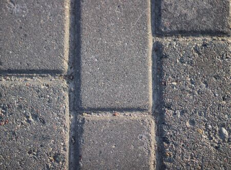 Gray brick paving slabs on the street
