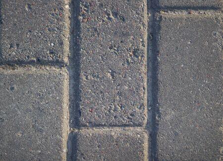Gray brick paving slabs on the street