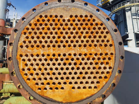 Shell-and-tube (shell-and-tube) heat exchanger for heat exchange between two streams close-up. Dirty pipes in the opened heat exchanger