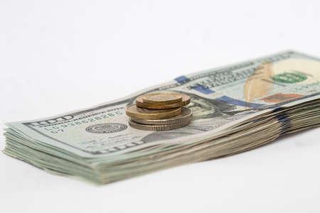 A stack of hundred-dollar bills on a white isolated background. 100 dollar bills Standard-Bild