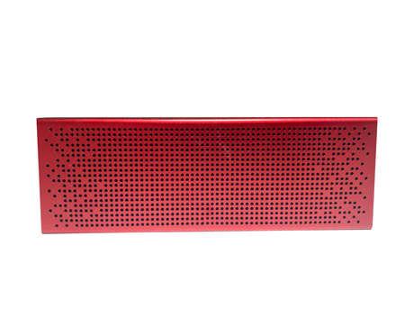 Portable red speaker for listening to music via close-up on a white isolated background. Mini speaker for music Standard-Bild
