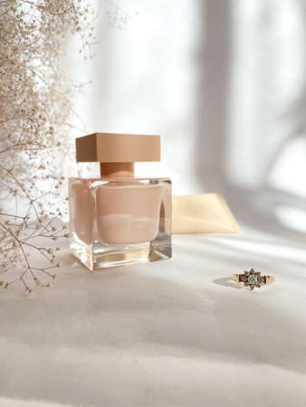 Perfume close-up on a white isolated background Standard-Bild