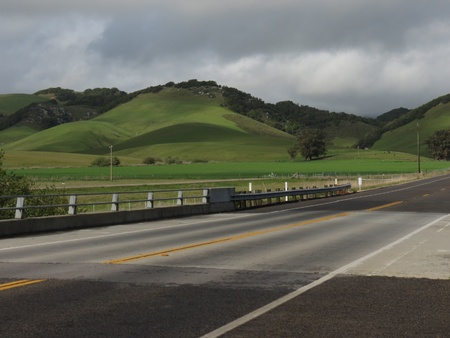 Shadows fall after late afternoon rain making many shades of green on California hills