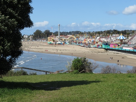 berm: Main beach in Santa Cruz and the boardwalk after the San Lorenzo River flood of late March 2012 and beach replenishment engineering to shore up the retaining wall  Editorial