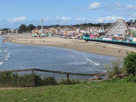 View from East Cliff Drive cliffs by Point San Lorenzo of the boardwalk and Main Beach Santa Cruz, after repairs were done to build a berm on the beach to defer potential damage to the east end of the boardwalk