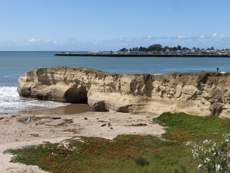 April 5, 2012, Main Beach replenishment project after flood of March. The sandstone point near the mouth of the San Lorenzo river in Santa Cruz, California extends into the blue water of Monterey Bay.