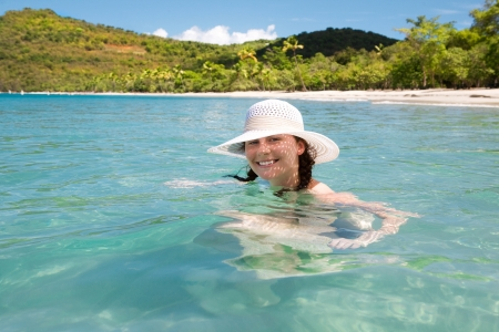 Young beautiful happy woman enjoys summer day at tropical island. Archivio Fotografico