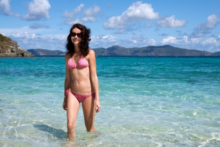 virgin islands: Young beautiful happy woman enjoys summer day at tropical island. Stock Photo