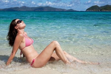 thomas: Young beautiful happy woman enjoys summer day at tropical island. Stock Photo