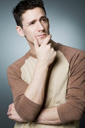 Young handsome man resolving a problem. Archivio Fotografico