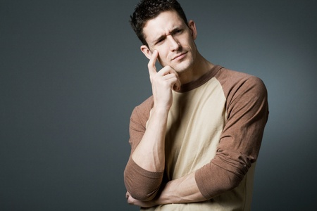 resolving: Young handsome man resolving a problem. Stock Photo
