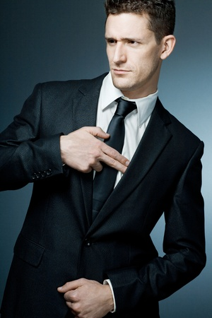 Young handsome businessman making gun gesture. Archivio Fotografico