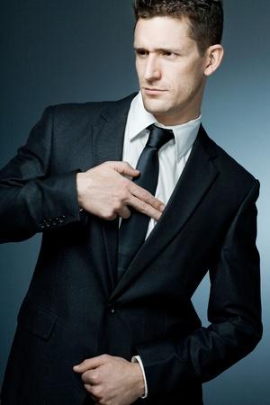 Young handsome businessman making gun gesture. 版權商用圖片