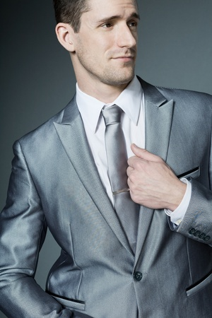 Young handsome businessman in silver suit.