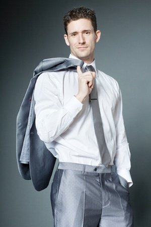 Young handsome businessman in silver suit. photo