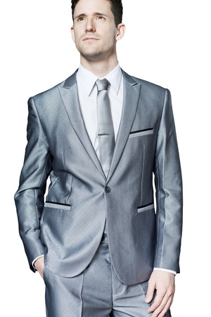 Young businessman standing in confident pose. Isolated.
