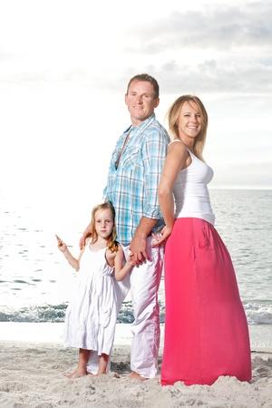 Happy family enjoy summer day at tropical beach. Archivio Fotografico