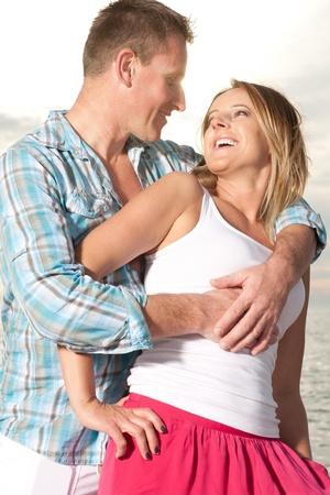 Happy couple enjoy summer day at the beach. Archivio Fotografico