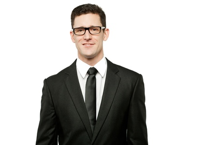 Young handsome businessman in black suit on white.