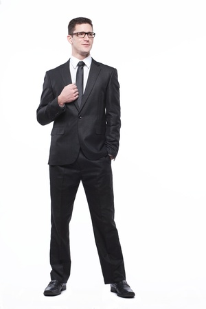 Young handsome businessman in black suit on white