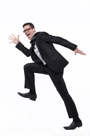 Young happy businessman runs in black suit on white