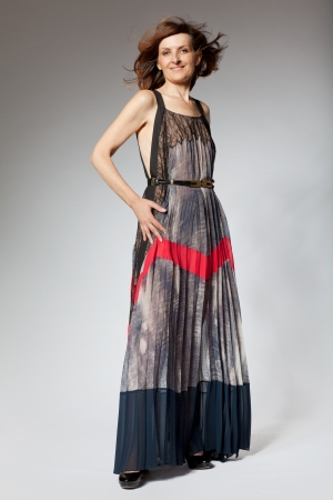 Attractive happy middle-aged woman in long dress