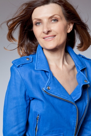 Attractive happy middle-aged woman in blue jacket