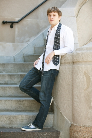 Young handsome man in white shirt relaxing   Archivio Fotografico