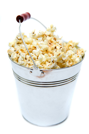 buttered: Bucket of popcorn isolated on a white background. Stock Photo