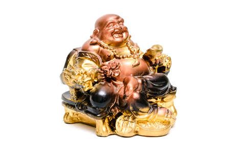 lucky charm: The figure of the Buddha statuette Asian religion.