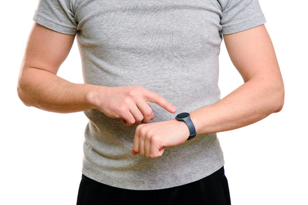 Sport man show fitness tracker in his hand.