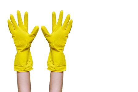 Hands up yellow rubber cleaning gloves closeup. Isolated on white background. Place for text. Copy space. Stock Photo