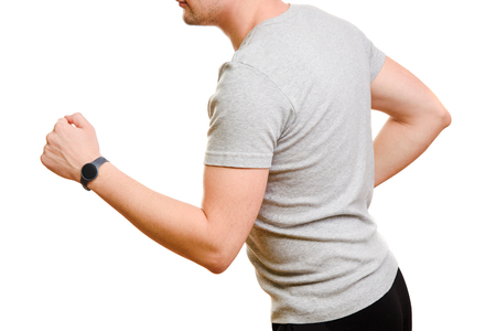 Running man with fitness tracker on hand. Isolated on white background. Stock Photo