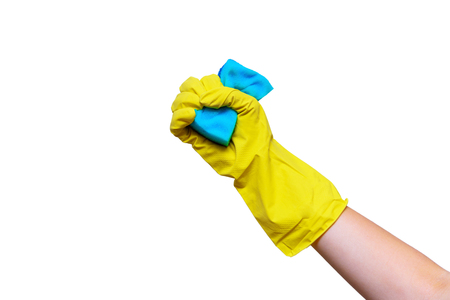 Hand in yellow glove compresses the sponge for washing. Isolated on white background.