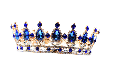 Gold crown with blue jewel of precious stones. Stock Photo